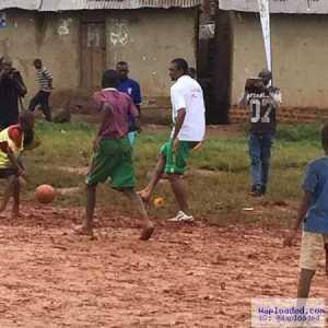 Awww! Football Legend, Kanu Nwankwo Spotted Playing Street Football in the Mud With Kids In Uganda (Photos)